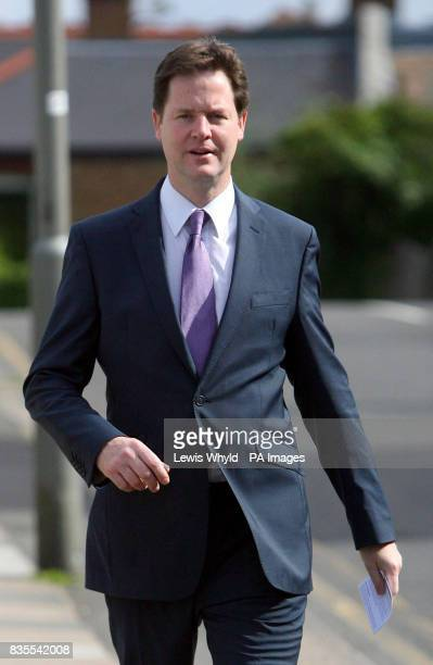 Lib Dem leader Nick Clegg arrives at a polling station at Dryburgh Hall in Putney London to vote in the European election