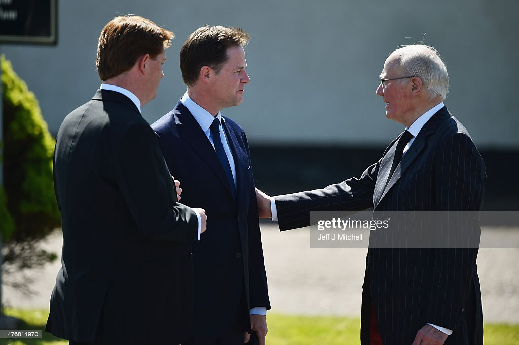 Lib Dem politicians Nick Clegg, Danny Alexander and Menzies Campbell attend the funeral service of former Liberal Democrat leader Charles Kennedy at St John's Roman Catholic Church on June 12, 2015 in Fort William, Scotland. Mr Kennedy died at his home in Fort William on 1 June at the age of 55 after suffering a major haemorrhage as a result of his battle with alcoholism.