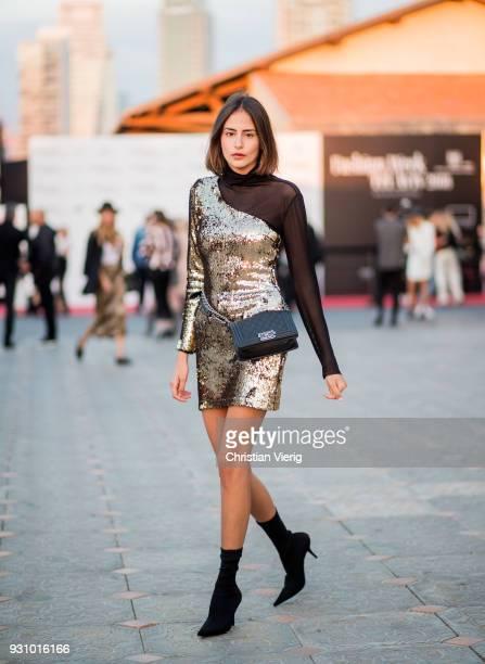 Libar Balilti wearing golden dress black Chanel bag is seen during Tel Aviv Fashion Week on March 12 2018 in Tel Aviv Israel