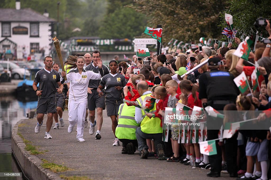 Libby Anderson carries the Olympic Torch along the canal at the Pontcysyllte Aqueduct, a UNESCO World Heritage Site on May 30, 2012 in Llangollen, Wales. The Olympic Flame is now on day 11 of a 70-day relay involving 8,000 torchbearers covering 8,000 miles. carries the Olympic Torch on a hand drawn canal boat across the Pontcysyllte Aqueduct, a UNESCO World Heritage Site on May 30, 2012 in Llangollen, Wales. The Olympic Flame is now on day 12 of a 70-day relay involving 8,000 torchbearers covering 8,000 miles.