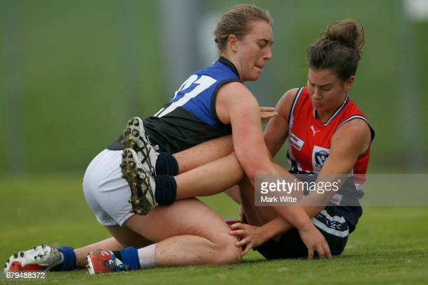 Libby Birch of Darebin Falcons and Jessica Anderson of Melbourne Uni fight for the ball during the round one VFL Women's match between the Darebin...