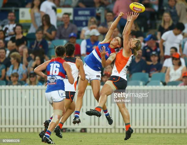 Libby Birch of the Bulldogs and Cora Staunton of the Giants contest a mark during the round six AFLW match between the Greater Western Sydney Giants...