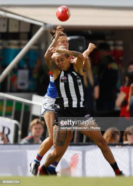 Libby Birch of the Bulldogs and Moana Hope of the Magpies collide during the 2018 AFLW Round 05 match between the Collingwood Magpies and the Western...