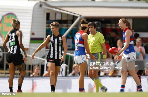 Libby Birch of the Bulldogs is reported after a collision with Moana Hope of the Magpies during the 2018 AFLW Round 05 match between the Collingwood...