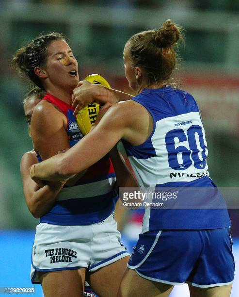 Libby Birch of the Bulldogs is tackled during the round three AFLW match between the North Melbourne Kangaroos and the Western Bulldogs at the...