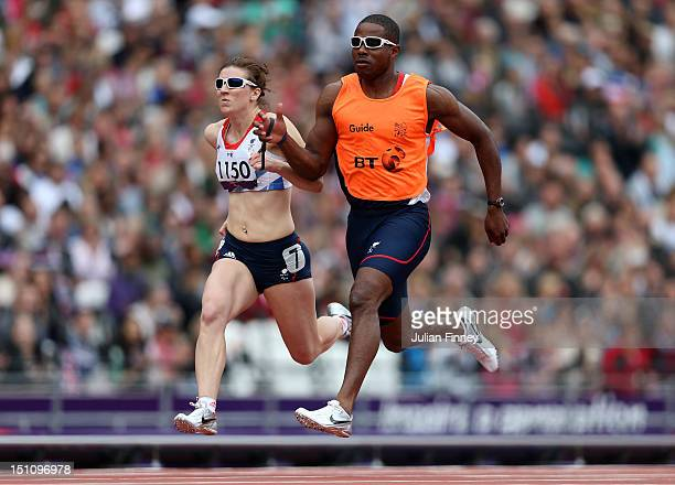 Libby Clegg of Great Britain and guide Mikail Huggins compete in the Women's 100m T12 heats on day 3 of the London 2012 Paralympic Games at Olympic...