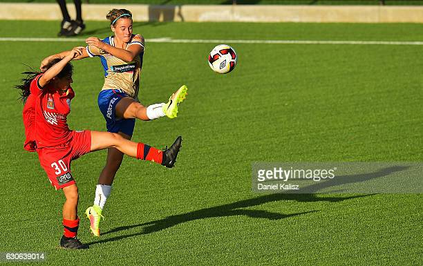 Libby CopusBrown of the Jets strikes the ball as Alex Chidiac of United defends during the round nine WLeague match between Adelaide and Newcastle at...