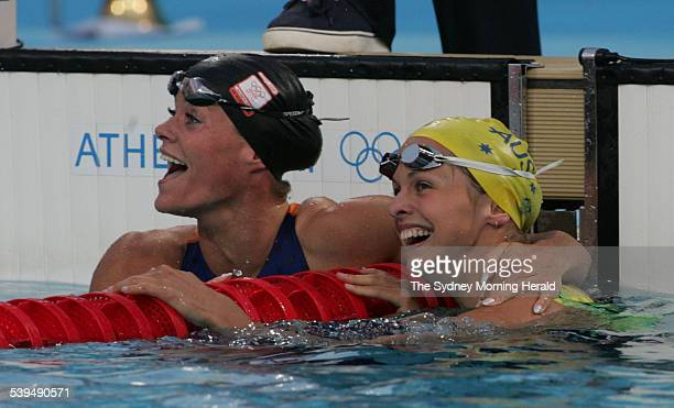 Libby Lenton after her bronze medal win in the 50m freestyle congratulates gold medal winner Inge de Bruijn at the Athens Olympics on 21 August 2004...