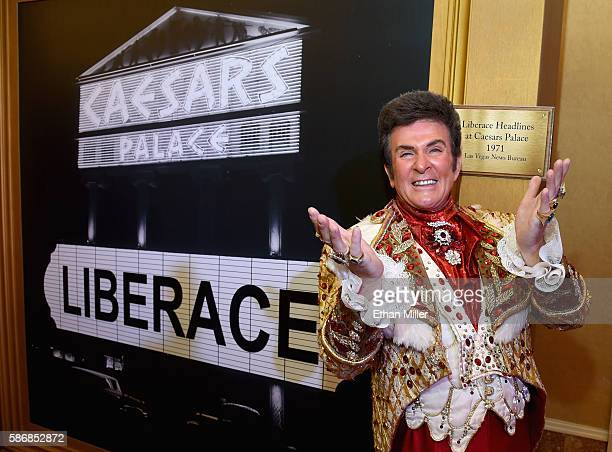 Liberace impersonator Daryl Wagner poses in front of a 1971 Las Vegas News Bureau photo of Liberace's name on the Caesars Palace marquee during the...