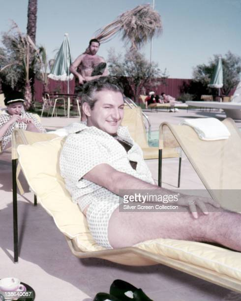 Liberace US pianist and entertainer reclining on a yellow sun lounger circa 1965