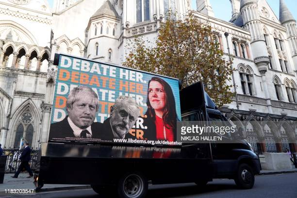 A Liberal Democrat advertising van drives past the High Court in London as the Liberal Democrats bring an action to the court after being excluded...