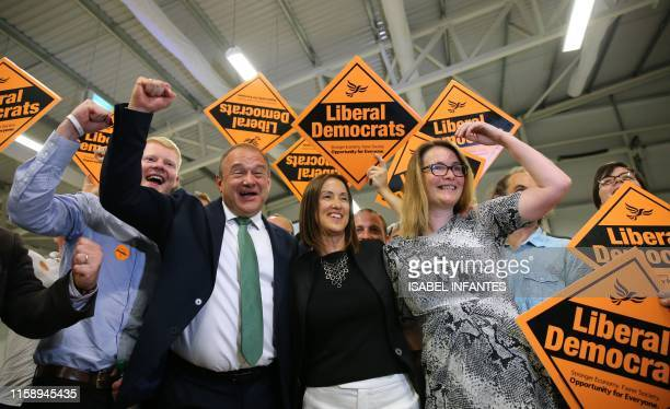 Liberal Democrat candidate Jane Dodds celebrates with Liberal Democrat MP Ed Davey and her team after winning the Brecon and Radnorshire byelection...