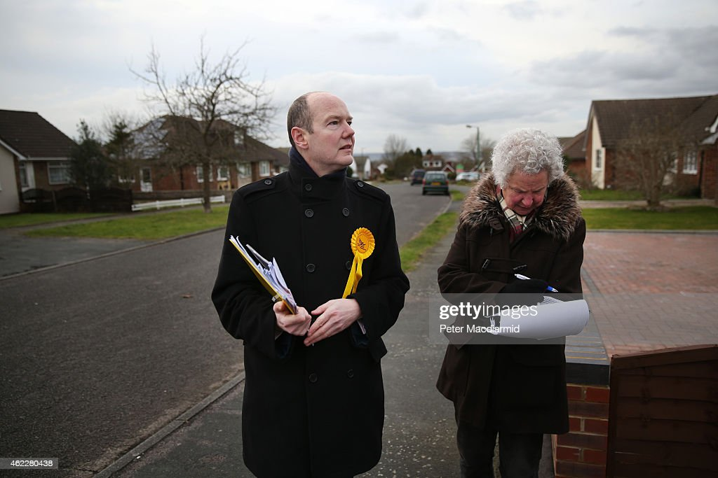 Liberal Democrat candidate Jasper Gerard (L) canvasses for votes in the Maidstone and the Weald constituency on January 26, 2015 in Maidstone, England. Campaigning for the May 7th general election is well under way with just over 100 days to go to polling day.