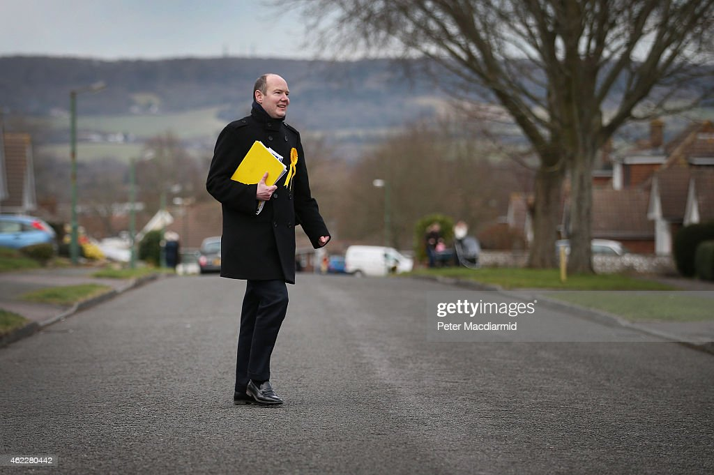 Liberal Democrat candidate Jasper Gerard crosses a residential street as he campaigns for votes in the Maidstone and the Weald constituency on January 26, 2015 in Maidstone, England. Campaigning for the May 7th general election is well under way with just over 100 days to go to polling day.