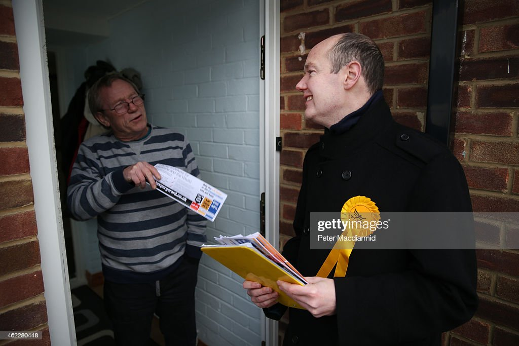 Liberal Democrat candidate Jasper Gerard (R) talks to a resident as he campaigns for votes in the Maidstone and the Weald constituency on January 26, 2015 in Maidstone, England. Campaigning for the May 7th general election is well under way with just over 100 days to go to polling day.