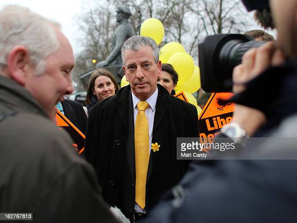 Liberal Democrat candidate Mike Thornton speaks with television and newspaper reporters as he campaigns in the forthcoming by-election on February...