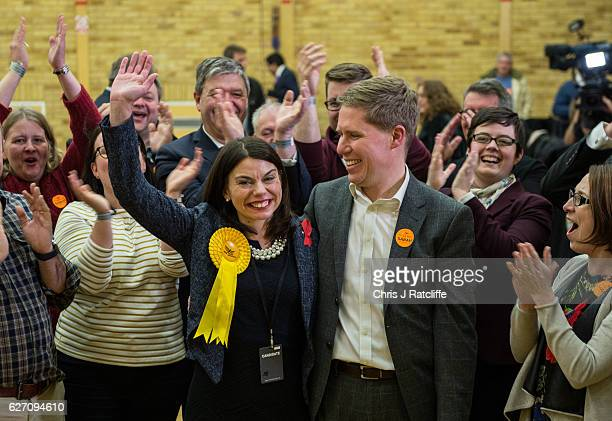 Liberal Democrat candidate Sarah Olney and her husband Ben pose for photos with supporters after being announced as the winner of the Richmond Park...