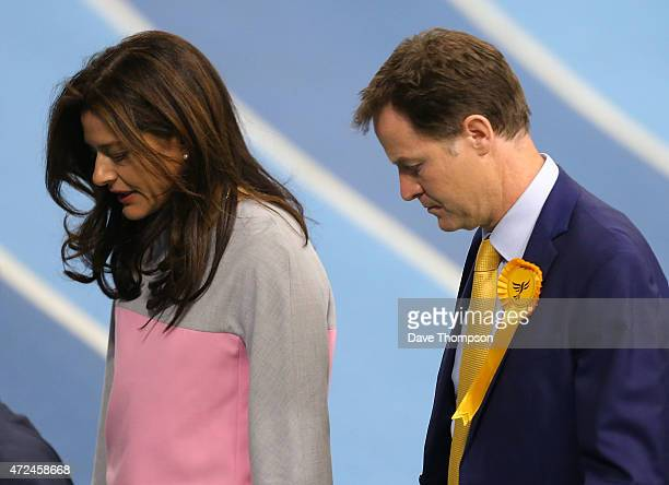 Liberal Democrat leader and Deputy Prime Minister Nick Clegg and his wife Miriam Gonzalez Durantez look dejected as they leave his constituency...