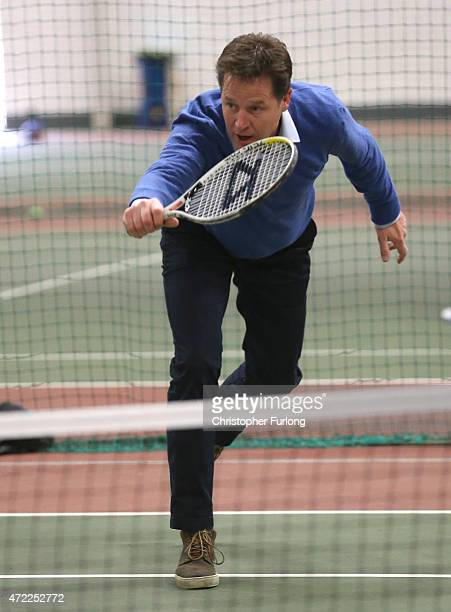 Liberal Democrat leader and Deputy Prime Minister Nick Clegg plays tennis against his wife Miriam Gonzalez Durantez during a visit to Tudor Grange...