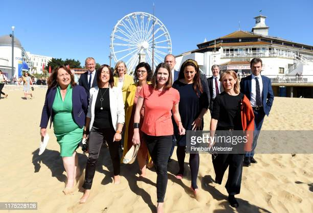 Liberal Democrat leader Jo Swinson and fellow MP's take a walk on Bournemouth beach before before she delivers her first leader's speech at the...