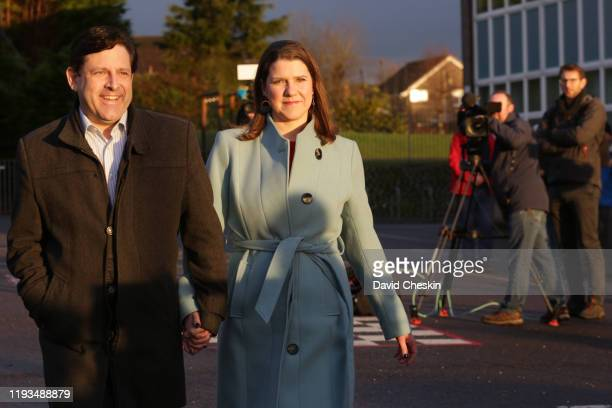 Liberal Democrat Leader Jo Swinson and her husband Duncan Hames arrive to vote at Castlehill Primary School on December 12 2019 in Bearsden near...