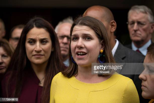 Liberal Democrat leader Jo Swinson and Labour MP Luciana Berger join a group of cross party MPs outside the Houses of Parliament on September 11 2019...