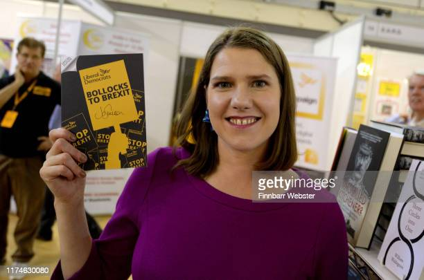 Liberal Democrat leader Jo Swinson signs their 'Bollocks to Bexit' manifesto as she tours the trade stands in the exhibition hall at the Liberal...