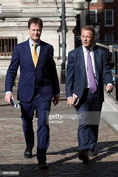 Liberal Democrat leader Nick Clegg and Chair of the Liberal Democrat Manifesto Group David Laws arrive to outline their manifesto expenditure at The...