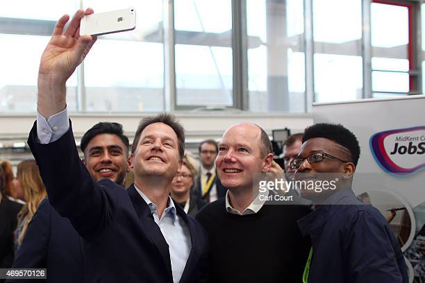 Liberal Democrat leader Nick Clegg and local Liberal Democrat candidate for Maidstone Jasper Gerard take a selfie photograph as they meet with...