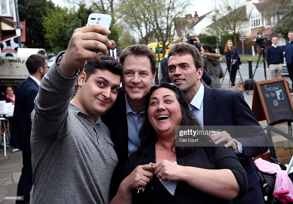 Liberal Democrat leader Nick Clegg (C) and local Liberal Democrat candidate Tom Brake (R) pose for a selfie photograph after a visit to an art gallery on April 13, 2015 in Carshalton, England. The party leader is continuing to tour the country as he campaigns ahead of the forthcoming general election.