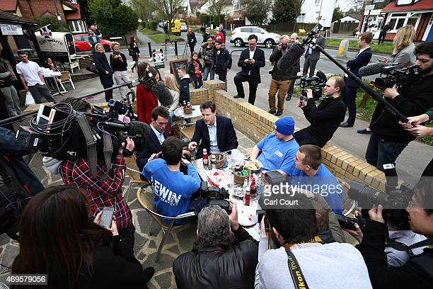 Liberal Democrat leader Nick Clegg chats with builders during a visit to a cafe on April 13 2015 in Carshalton England The party leader is continuing...