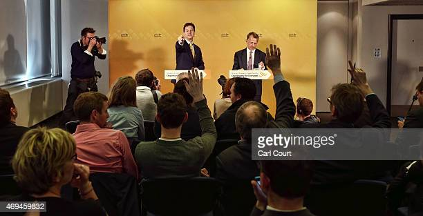 Liberal Democrat leader Nick Clegg gestures as he outlined his party's manifesto expenditure during a press conference with Chair of the Liberal...