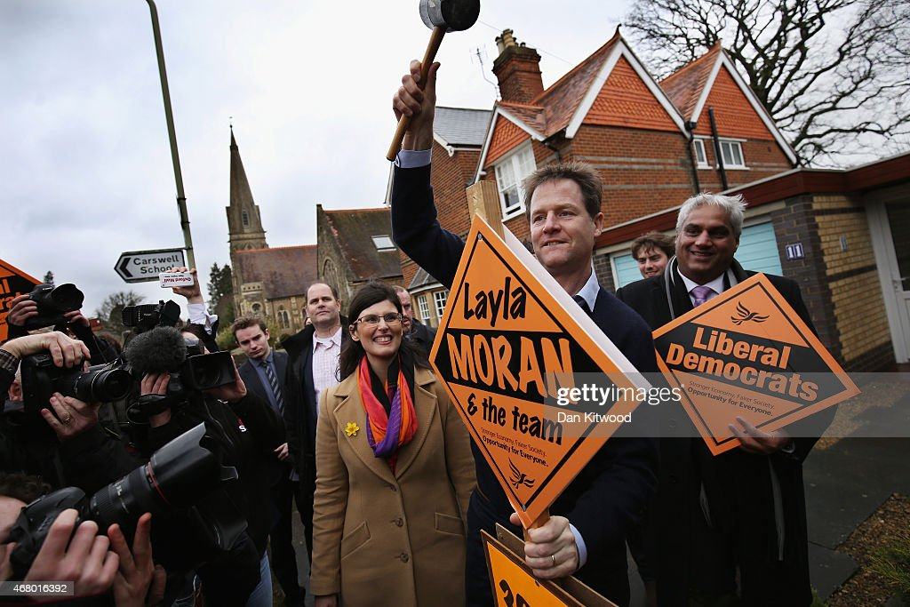 Liberal Democrat leader Nick Clegg hammers in the 300th Lib Dem stake board as Oxford West and Abingdon Layla Moran looks on after speaking to activists as he launches the party's General Election 2015 campaign on March 29, 2015 in Abingdon, England. The Liberal Democratic party started it's election campaign in the Oxford West and Abingdon consituancy today where Mr Clegg unveiled the Liberal Democrat election battle bus and met with candidate for Oxford West and Abingdon Layla Moran.