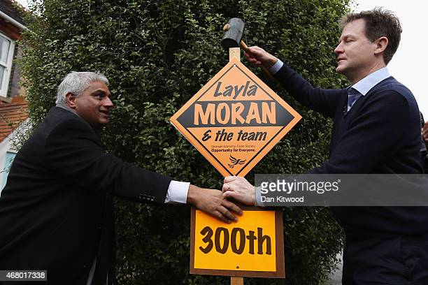 Liberal Democrat leader Nick Clegg hammers in the 300th Lib Dem stake board after speaking to activists and launching the party's General Election...