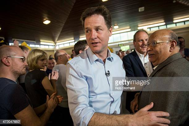 Liberal Democrat leader Nick Clegg is greeted by supporters at Galleywall Road Tenants Hall on May 3 2015 in London England Britain goes to the polls...