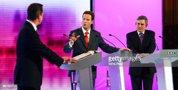 Liberal Democrat leader Nick Clegg makes a point to Conservative Party leader David Cameron as Prime Minister Gordon Brown looks on during the third...