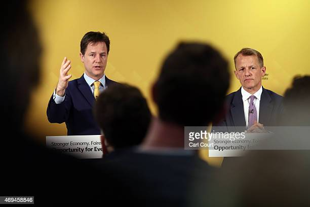 Liberal Democrat leader Nick Clegg speaks as Chair of the Liberal Democrat Manifesto Group David Laws looks on during a press conference in which the...