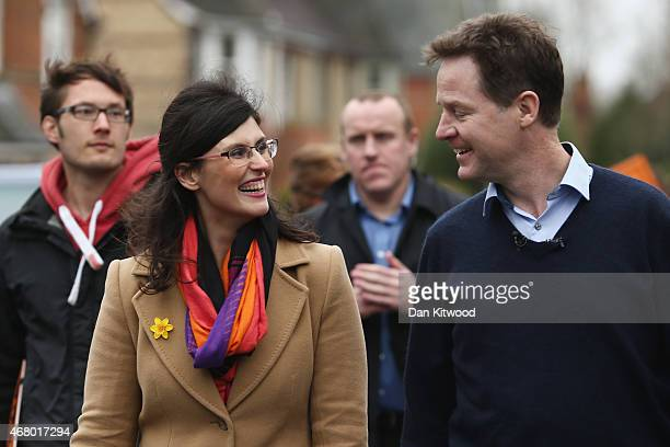 Liberal Democrat leader Nick Clegg walks back to the party bus with Layla Moran after launching the party's General Election 2015 campaign on March...