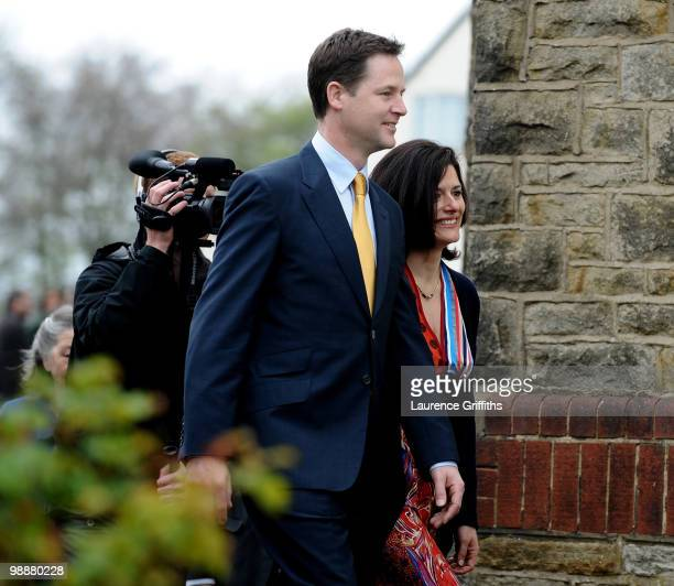 Liberal Democrat Leader Nick Clegg walks through a crowd after casting his vote with wife Miriam Gonzalez Durantez at Bents Green Methodist Church on...
