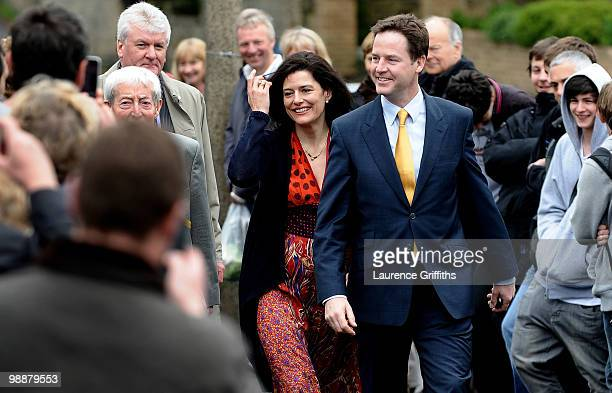 Liberal Democrat leader Nick Clegg walks through a crowd on his way to casting his vote with wife Miriam Gonzalez Durantez at Bents Green Methodist...