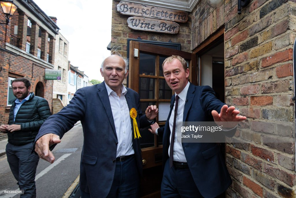 Liberal Democrat Leader Tim Farron (R) and former Secretary of State for Business, Innovation and Skills Vince Cable (L) leave a wine bar as they campaign in Twickenham on June 7, 2017 in Twickenham, England. Mr Cable is campaigning to retake his former seat after it was won by Conservative Tania Mathias in the 2015 general election. Britain goes to the polls tomorrow June 8 in a general election.