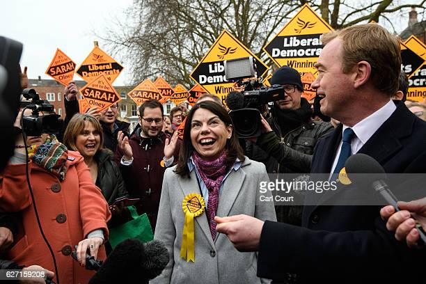 Liberal Democrat leader Tim Farron and Sarah Colney speak to the media following Colney's victory in the Richmond Park byelection on December 2 2016...