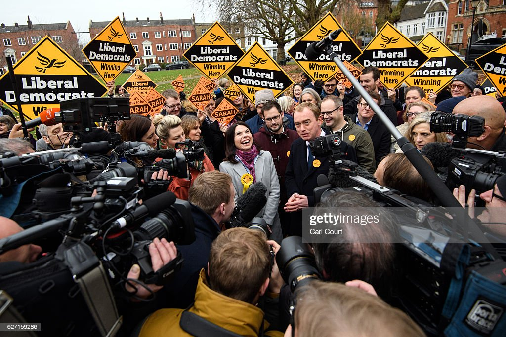 Liberal Democrat leader Tim Farron (R) and Sarah Colney (C) speak to the media following Colney's victory in the Richmond Park by-election on December 2, 2016 in London, England. The Liberal Democrats caused a major upset in the Richmond Park by-election after ousting ex-Tory MP Zac Goldsmith who resigned his seat in protest at Heathrow airport expansion.