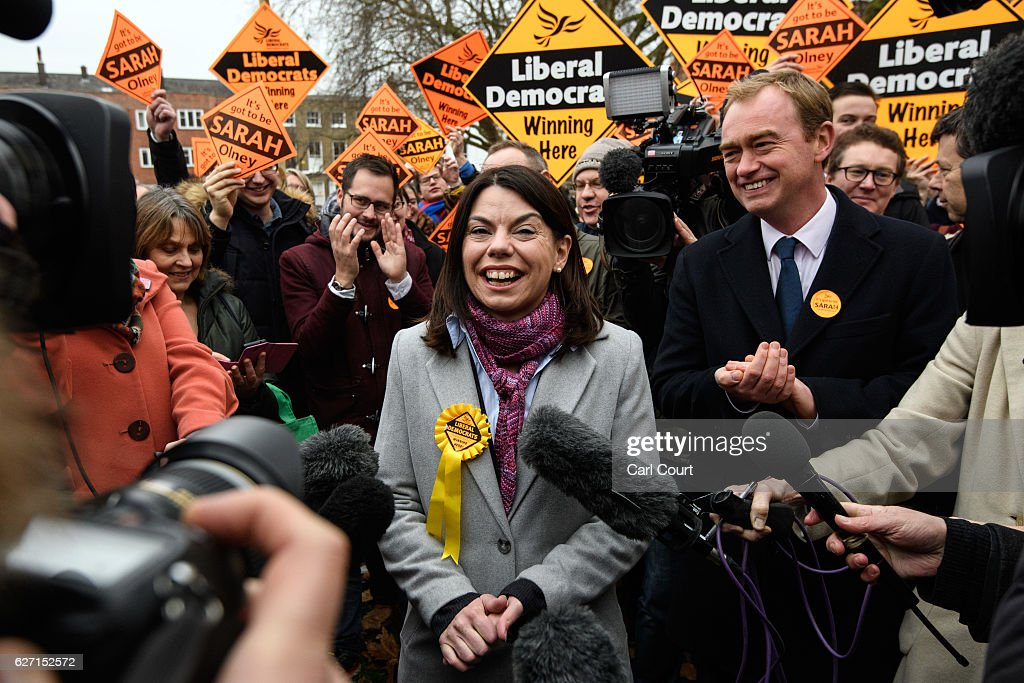 Liberal Democrat leader Tim Farron (R) and Sarah Olney (C) speak to the media following Colney's victory in the Richmond Park by-election on December 2, 2016 in London, England. The Liberal Democrats caused a major upset in the Richmond Park by-election after ousting ex-Tory MP Zac Goldsmith who resigned his seat in protest at the Heathrow airport expansion.