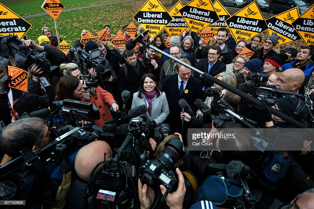 Liberal Democrat leader Tim Farron (C-R) and Sarah Olney (C) speak to the media following Colney's victory in the Richmond Park by-election on December 2, 2016 in London, England. The Liberal Democrats caused a major upset in the Richmond Park by-election after ousting ex-Tory MP Zac Goldsmith who resigned his seat in protest at Heathrow airport expansion.