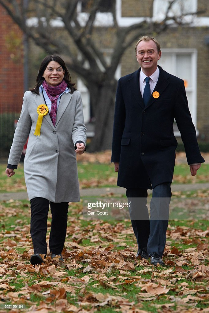 Liberal Democrat leader Tim Farron (R) and Sarah Olney walk to speak with waiting media following Olney's victory in the Richmond Park by-election on December 2, 2016 in London, England. The Liberal Democrats caused a major upset in the Richmond Park by-election after ousting ex-Tory MP Zac Goldsmith who resigned his seat in protest at Heathrow airport expansion.