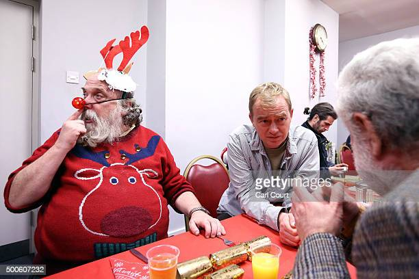 Liberal Democrat leader Tim Farron chats with a visitor during a visit to the Salvation Army homeless dropin centre on December 9 2015 in London...