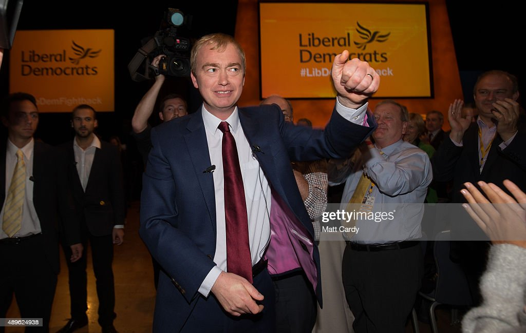 Liberal Democrat leader Tim Farron is congratulated as he leaves the main hall following his leader's speech on the final day of the Liberal Democrats annual conference on September 23, 2015 in Bournemouth, England. The Liberal Democrats are currently holding their annual conference using the hashtag #LibDemfightback in Bournemouth. The conference is the first since the party lost all but eight of its MPs in May's UK general election, however after gaining 20,000 new members since May the party is expecting a record attendance at the event being held at the Bournemouth International Centre.