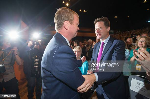 Liberal Democrat leader Tim Farron is congratulated by Nick Clegg as he leaves the main hall following his leader's speech on the final day of the...