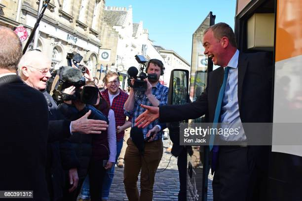 Liberal Democrat leader Tim Farron is greeted by former leader Ming Campbell now Lord Campbell as he steps off the party's general election 'battle...